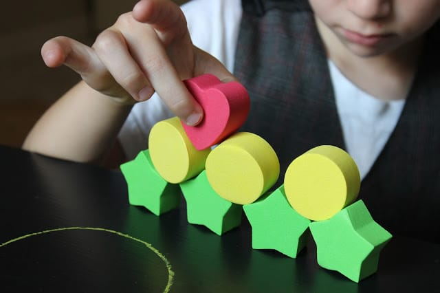 math games using foam shapes for preschooler with green stars, yellow circles and red hearts