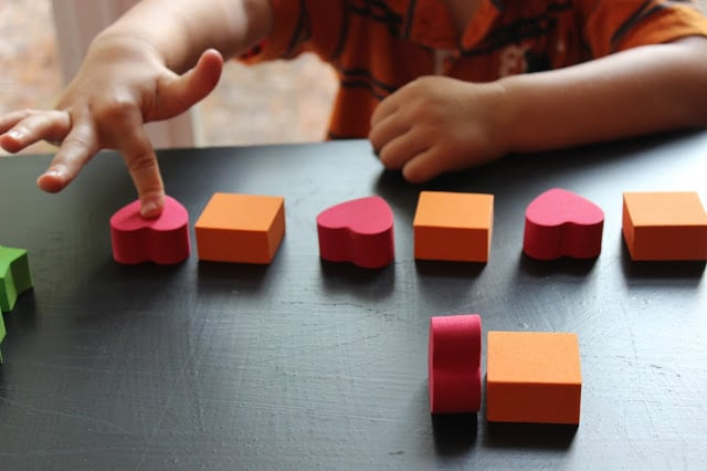 Patterning activity for preschoolers using red and orange foam shapes