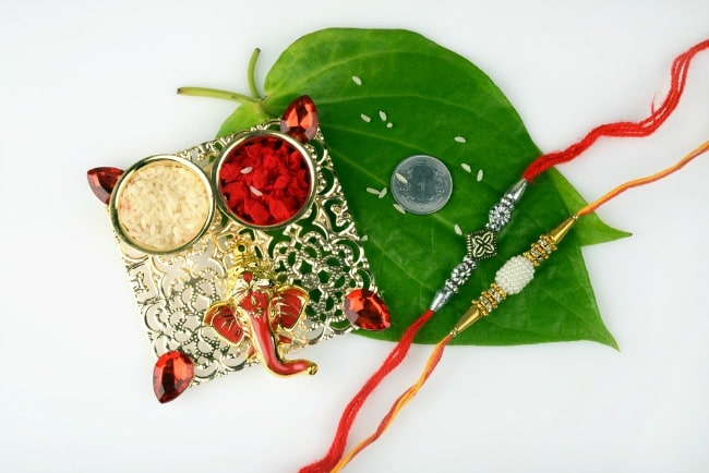 Display of items used for Raksha Bandhan with brother and sister.