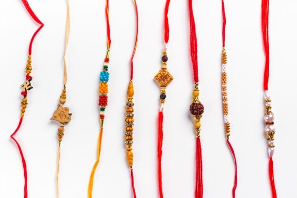 Several Rakhi bracelet with red threads and beads for Raksha Bandhan