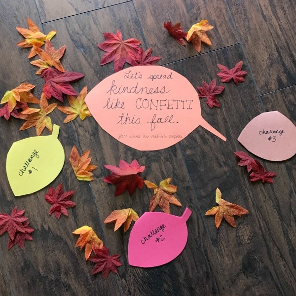 "Fall leaves with large leaf reading ""Let's spring kindness like confetti this fall."""