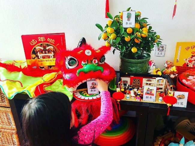 young girls learning about chinese dragon for Chinese New Year