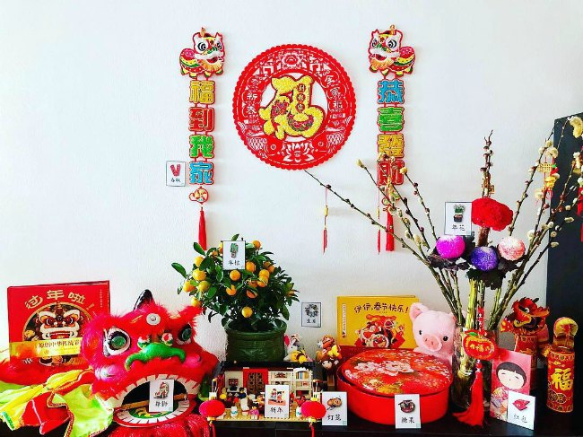 Chinese New Year decorations with books, activities and wall hangings