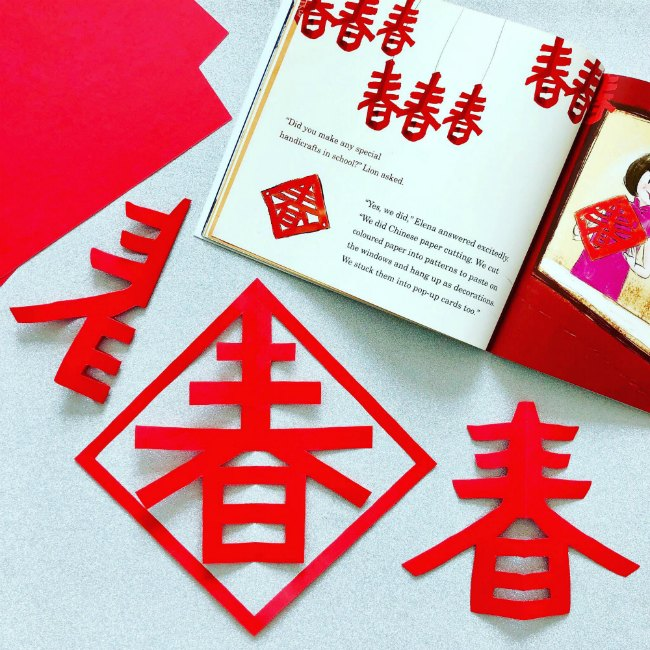 Red paper Chinese lanterns with book about Chinese New Year
