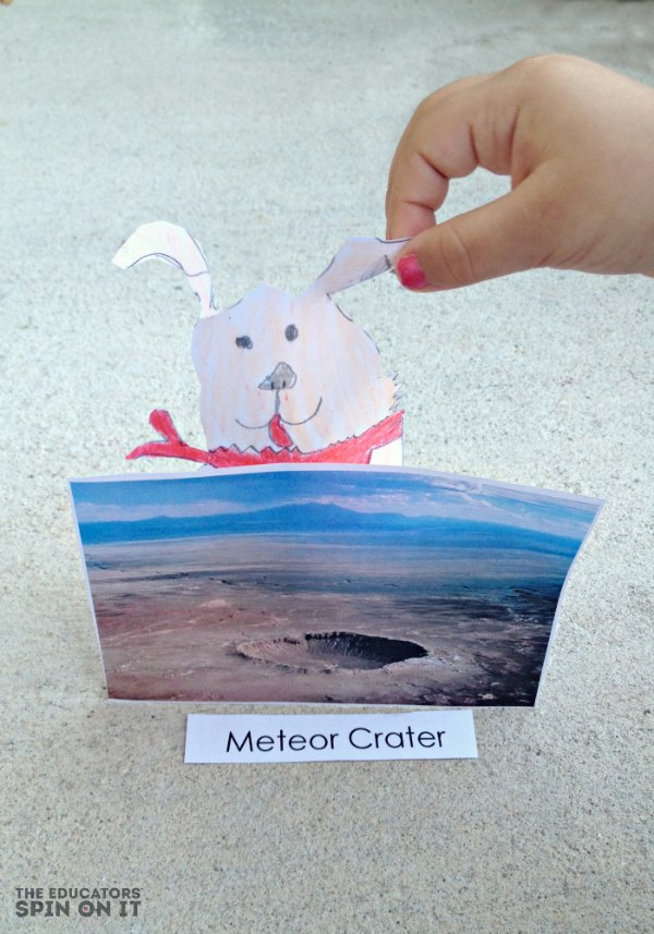 child holding image of meteor crater in Arizona with dog from story book