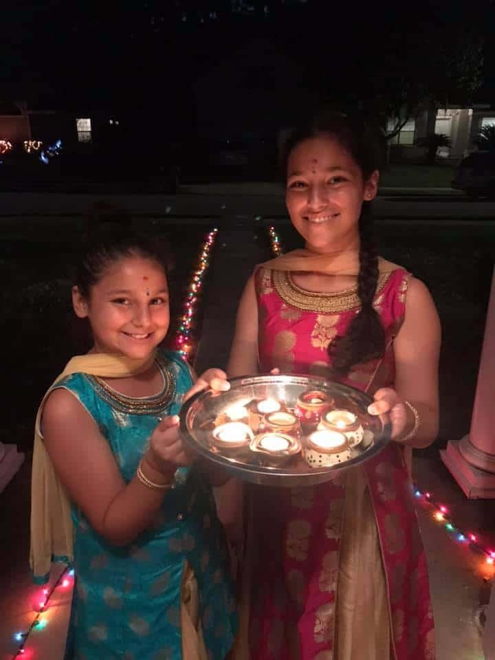 kids-celebrating-diwali-holding-diyas