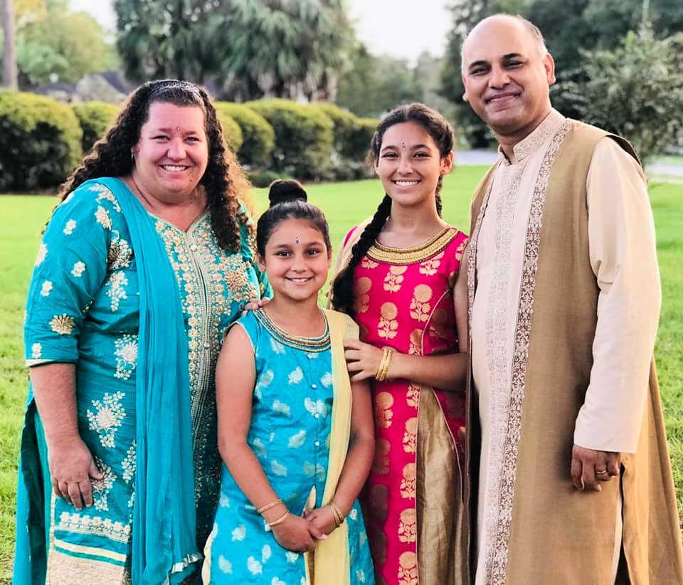 Family celebrating Diwali wearing traditional Indian clothing