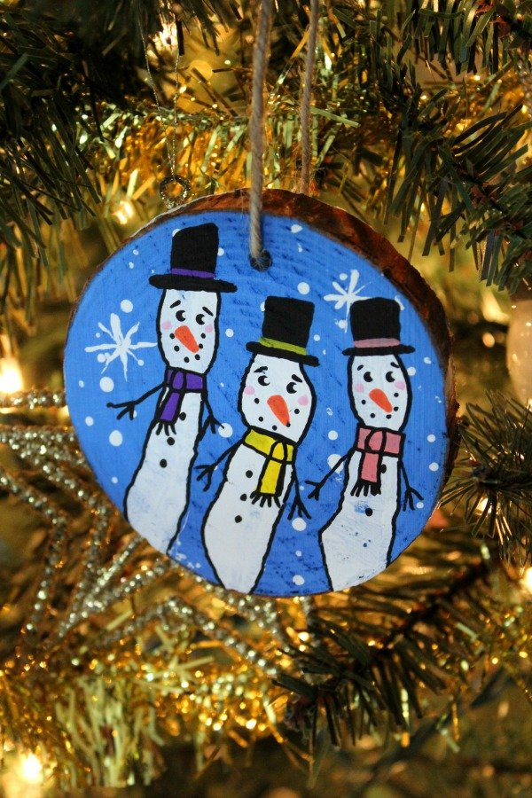 Snowman on wood slide using child's fingerprints