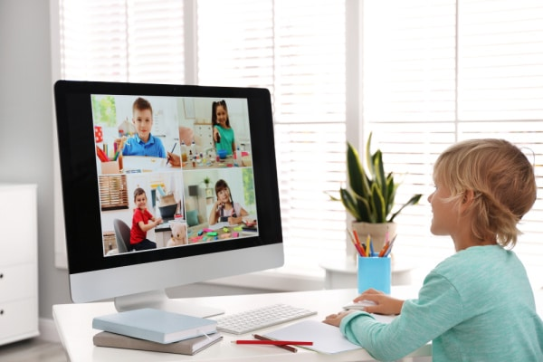 Child on virtual meeting with friends for playdate