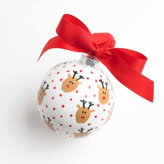 thumbprint reindeer ornament with polka dots